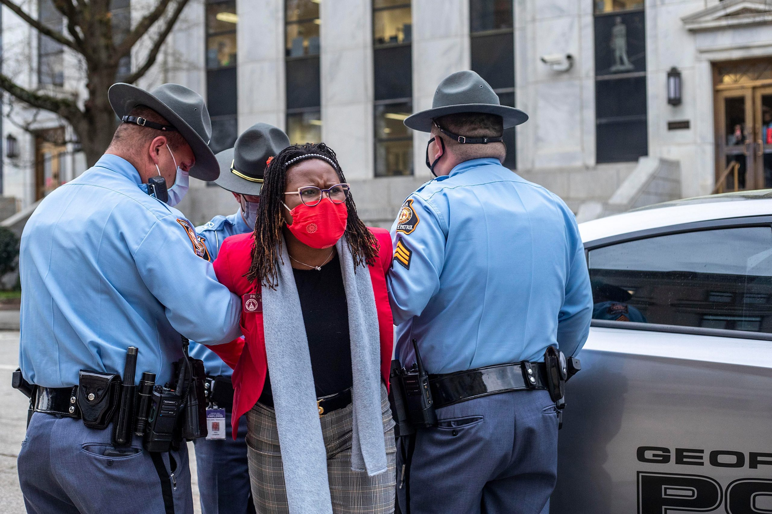 03/25/2021 —Atlanta, Georgia — Rep. Park Cannon (D-Atlanta) is placed into the back of a Georgia State Capitol patrol car after being arrested by Georgia State Troopers on day 38 of the legislative session at the Georgia State Capitol Building in Atlanta, Thursday, March 25, 2021. (Alyssa Pointer / Alyssa.Pointer@ajc.com)