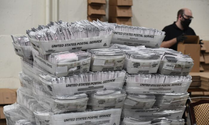 Mail-in ballots in their envelopes await processing at the Los Angeles County Registrar Recorders' mail-in ballot processing center in Pomona, Calif., on Oct. 28, 2020. (Robyn Beck/AFP via Getty Images)
